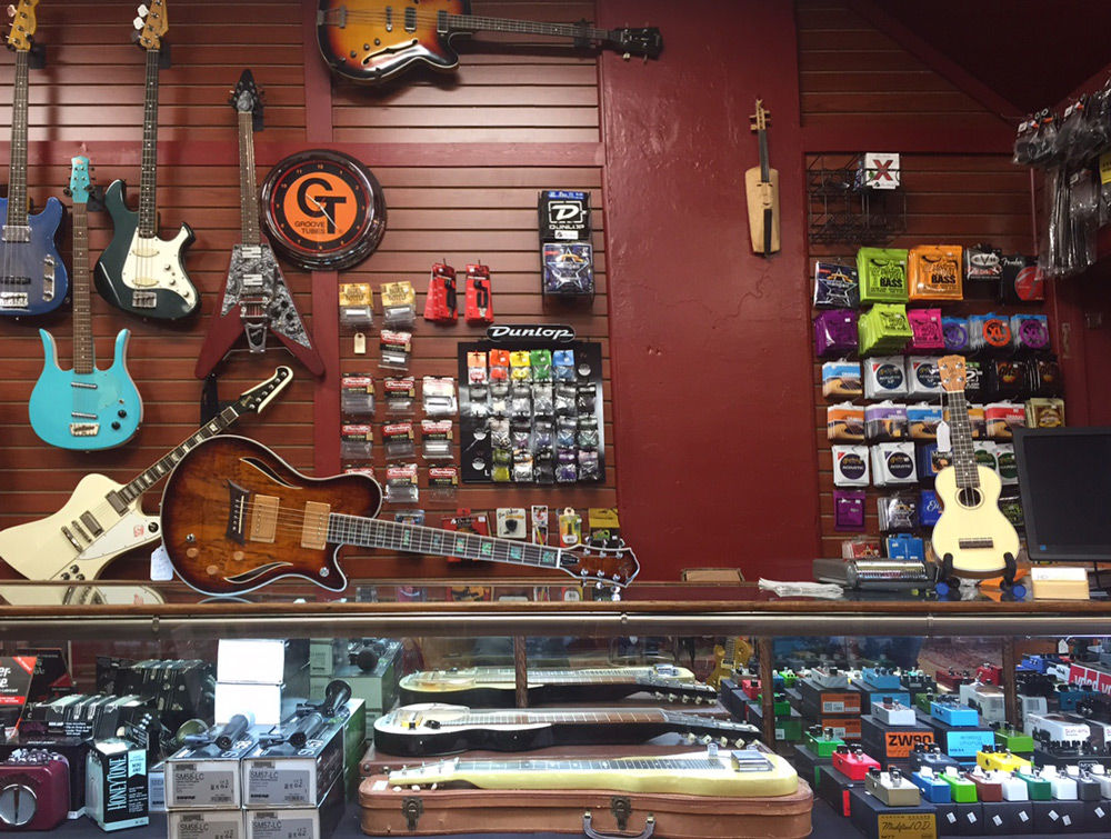 HD Custom Guitar Supply store counter with Michael Kelly MK Hybrid Electric-Acoustic Guitar