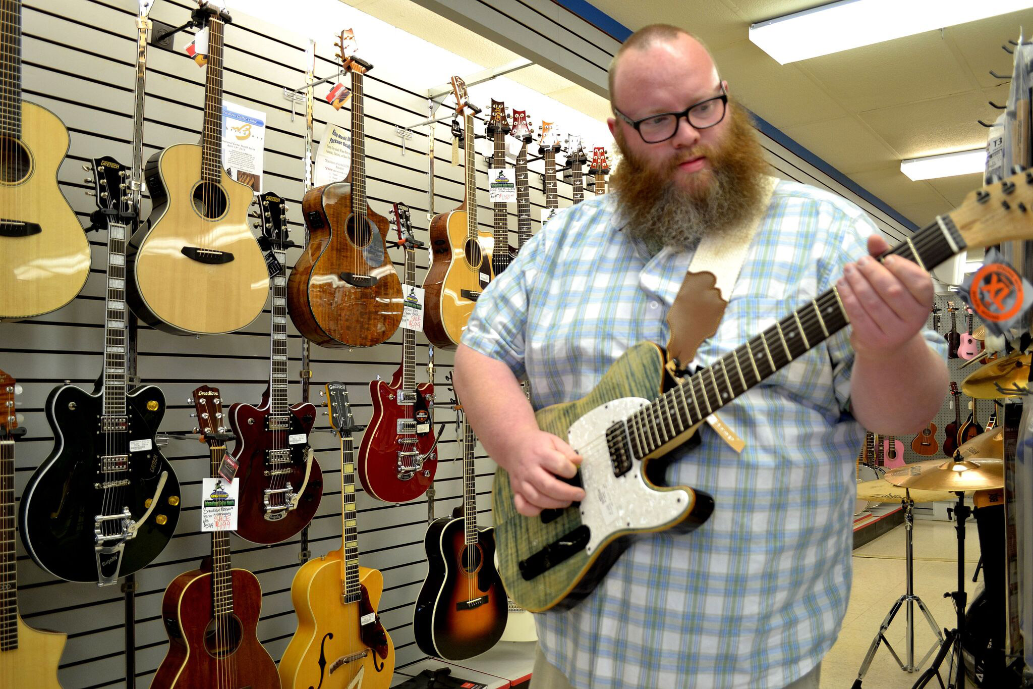 Jon from King Music Inc holding a Michael Kelly 1950s CC50 7-string electric guitar
