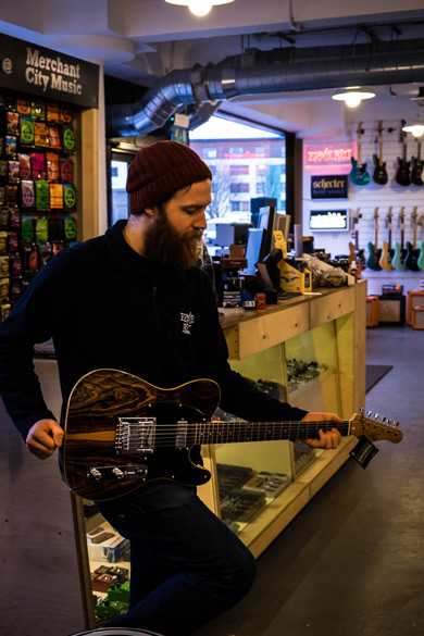 Merchant City Music staff playing with an MK 1950s Ebony electric guitar