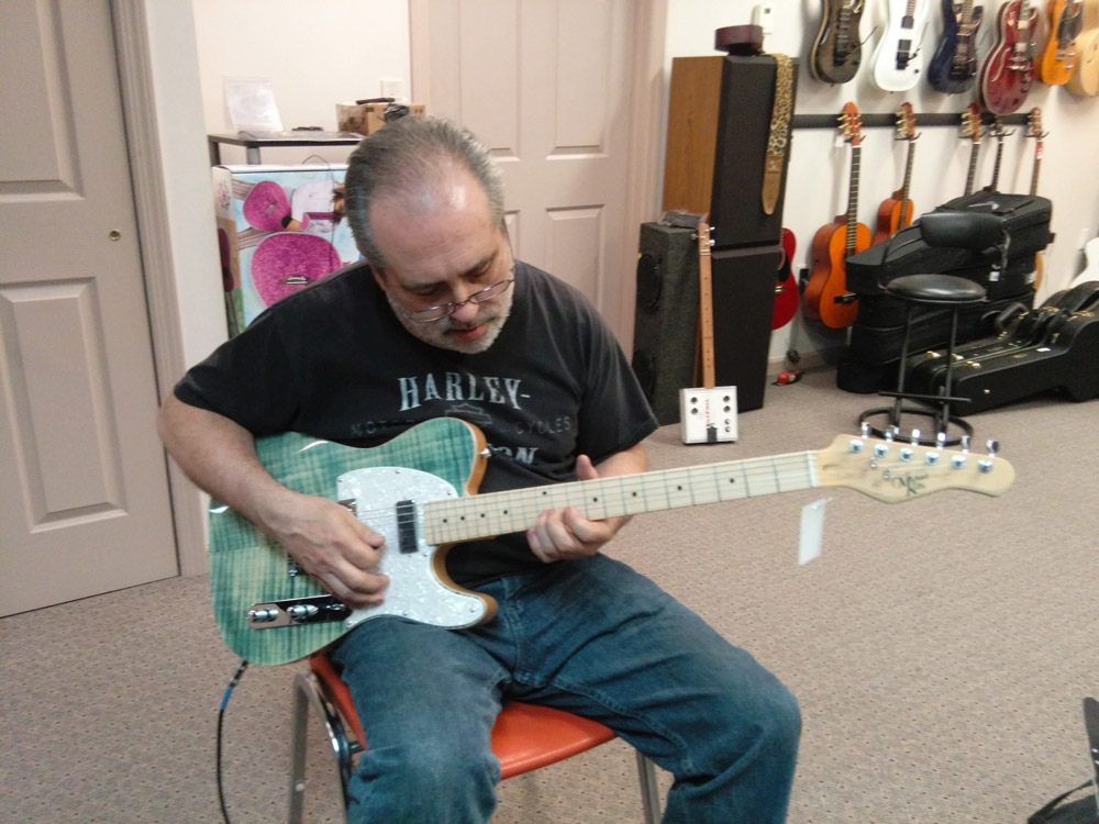 Student with a Michael Kelly 1950s electric guitar during guitar lessons at Robert Putt Studios.