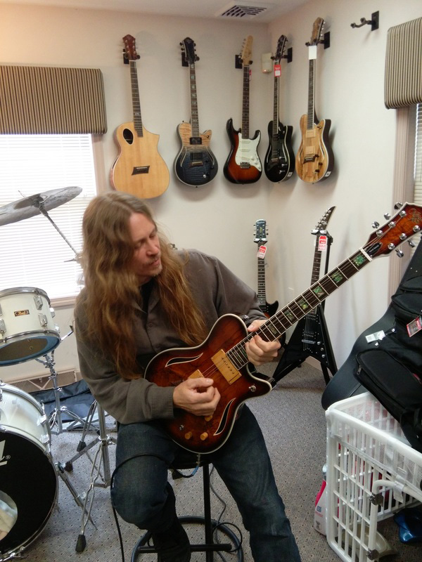Robert Putt playing a Michael Kelly Hybrid acoustic electric guitar