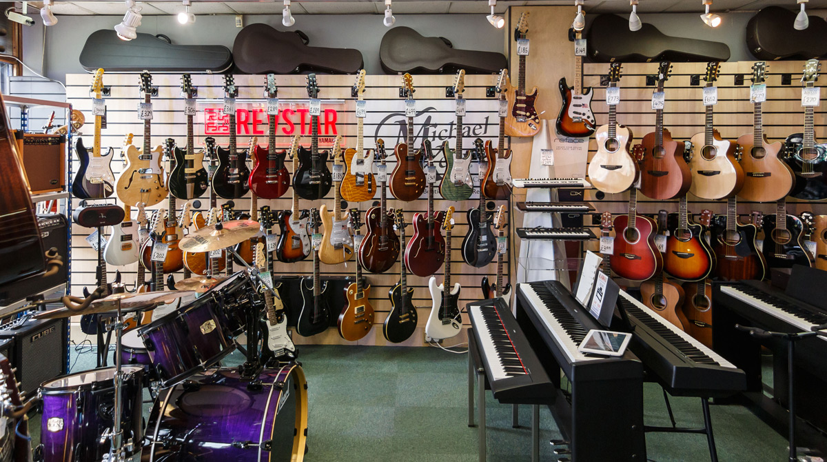 Electric and acoustic guitars at Strum & Bass music store