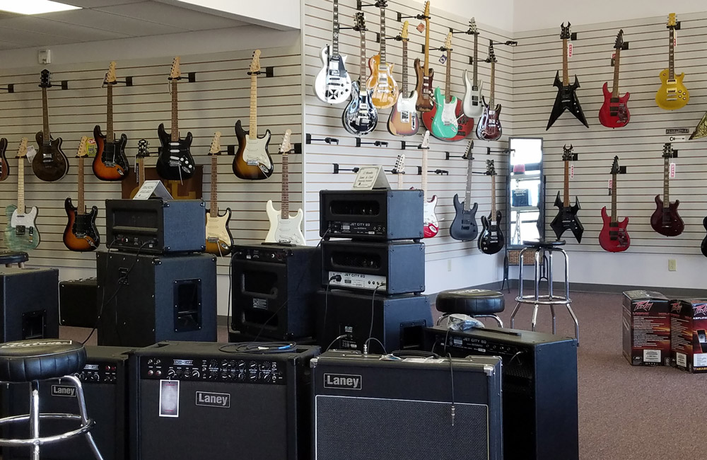 Electric guitars and amplifiers at The Musician's Den in Evansville, IN
