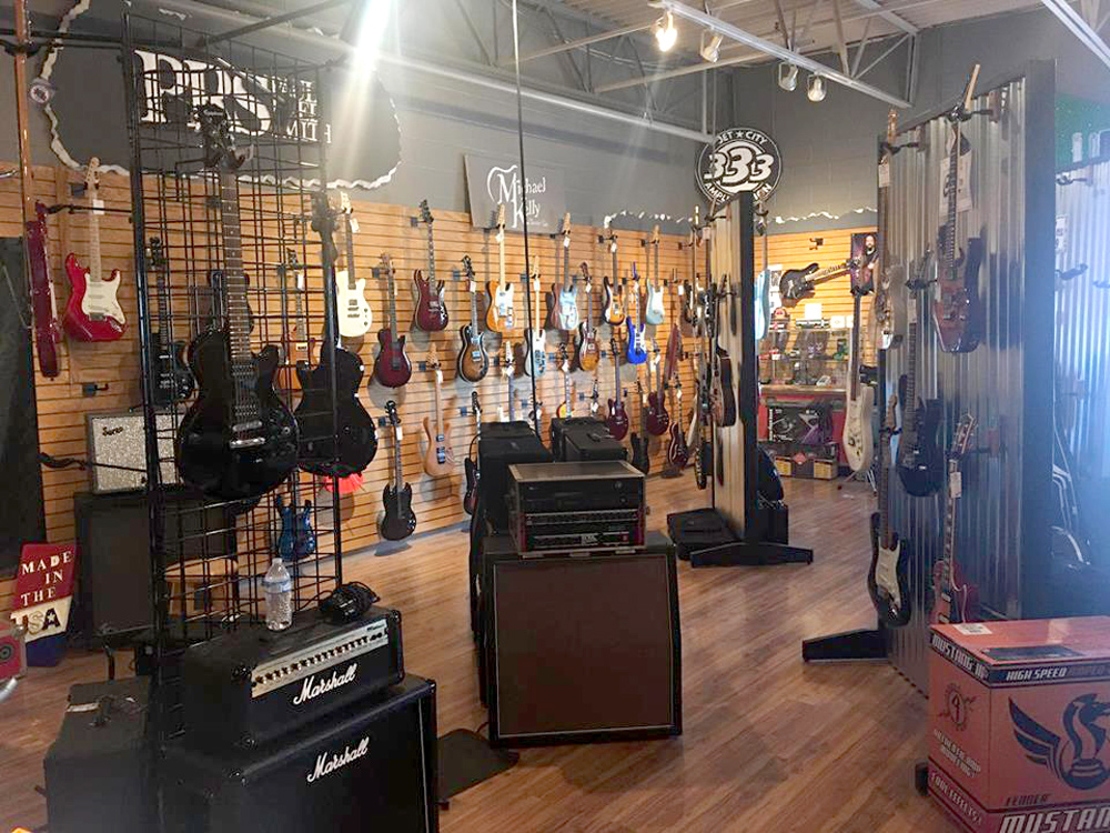 Michael Kelly 1950s, 1960s, and Patriot electric guitars and amps at Unga Bunga music store
