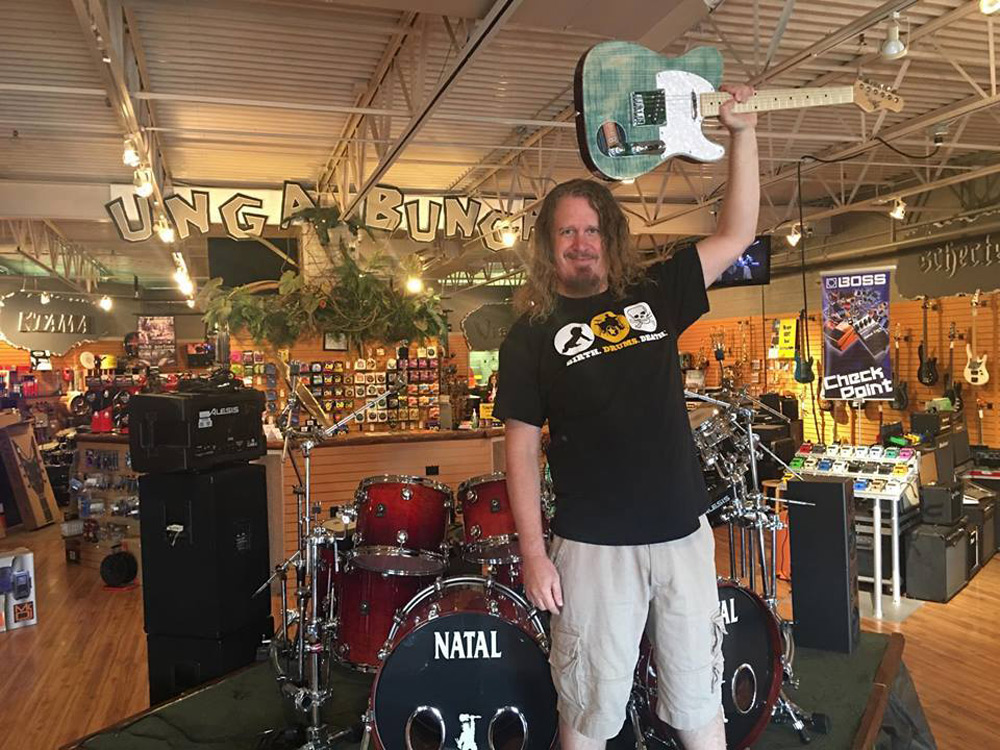 Unga Bunga music store with Michael Kelly 1950s electric guitar, guitar accessories, amplifiers, and other music instruments