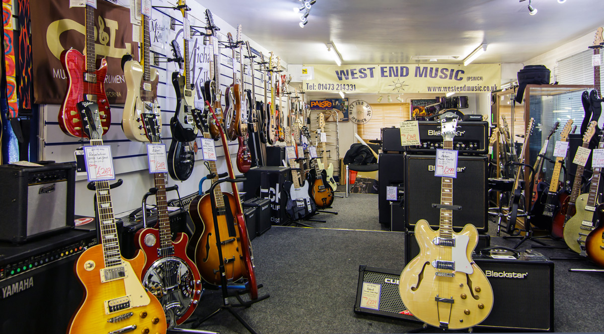 West End Music store with electric guitars, acoustic guitars, telecasters, stratocasters, amps, amplifiers, and guitar straps and guitar accessories